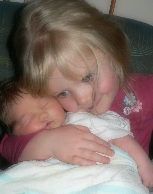 First Big Sister Cuddle at the Hospital