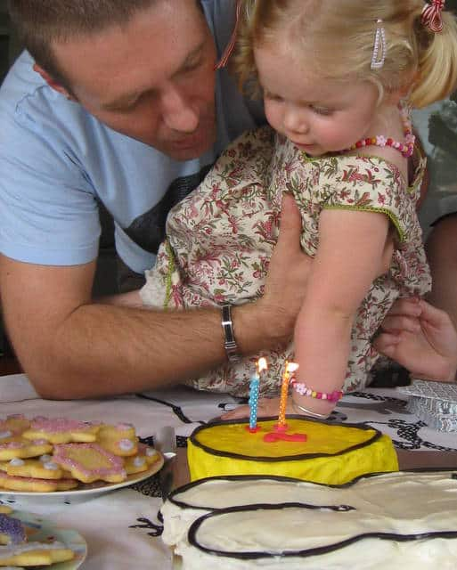 blowing out the candles on the miffy cake