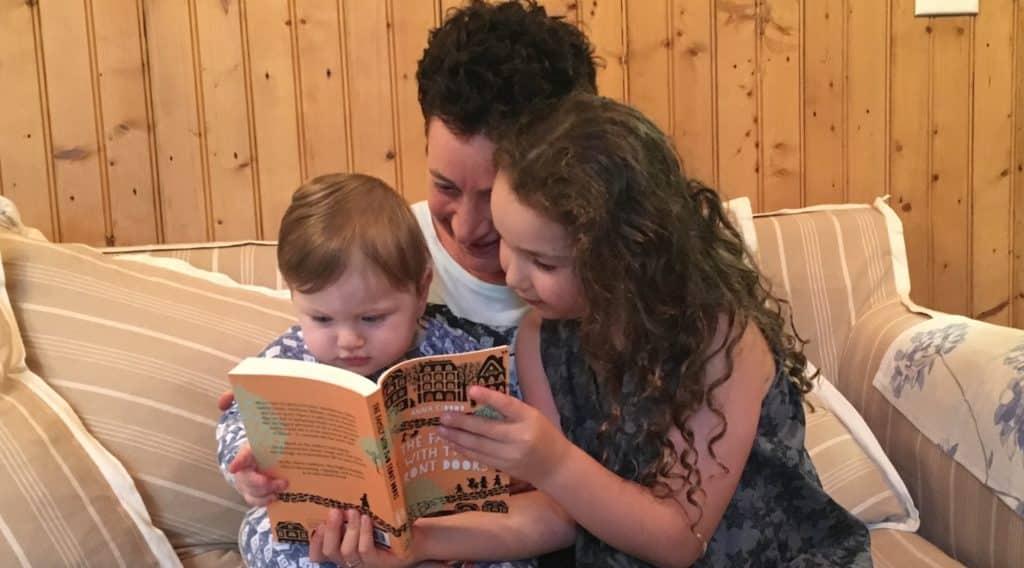 Anna's grandchildren reading an advance copy of her latest book!