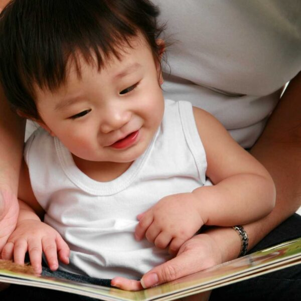 Best rhyming books for kids - baby being read to